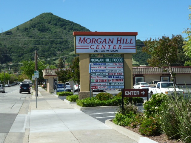Photo of Morgan Hill Center sign and parking lot off West Main Avenue, looking southwest.